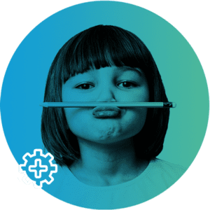 Little girl holding a pen between her lip and nose.