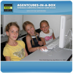 three middle school students sharing a computer