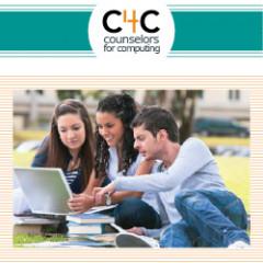 three students sharing a laptop